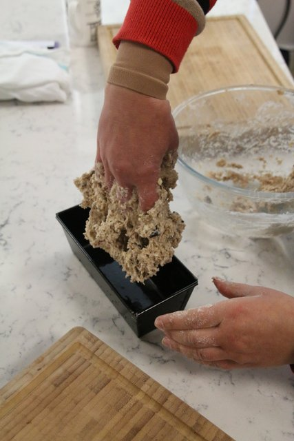 Filling the bread tin with the Wheaton bread  mix