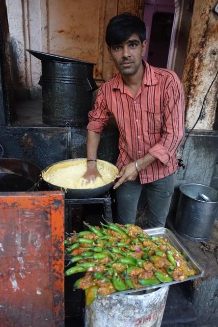 A street chef in Jodphur making Chili Pakodas