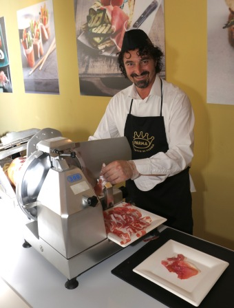 Carving ham at Parma's  prosciutto festival is skilled work